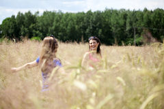 Friends on a field of grain Royalty Free Stock Photo