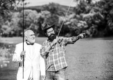 Friends fishing. Elegant bearded man and brutal hipster fishing. Perfect weekend. Hobby and recreation. Family day