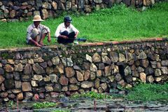 Fishing Mates. Friends fishing in the moat of the Imperial Citadel, Hue - Vietnam Royalty Free Stock Image