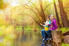 Friends fishing together with colorful fishrods Royalty Free Stock Photos