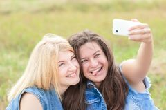 Friends fooling around with phone camera Royalty Free Stock Image