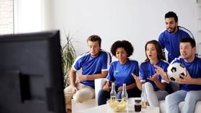 Friends or football fans watching soccer at home stock video