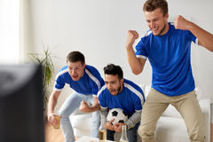 Friends or football fans watching soccer at home Royalty Free Stock Photo