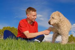 Friends forever. Teenager and his dog are friends forever Royalty Free Stock Image