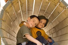 Friends forever. Happy smiling boys on the playground posing for the camera stock image