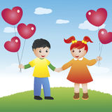 Friends forever. A boy and a girl holding hands are standing together on a green meadow. Several red heart-shaped balloons they are holding are up above against Stock Photos