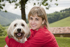 Friends forever. Beauty woman with her pet Royalty Free Stock Image