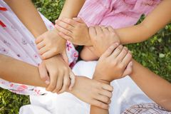 Friends forever. Three girls hold hands together, close up arms Royalty Free Stock Photos