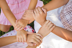 The friends forever. Friends forever - three girls hold hands together, close up arms Royalty Free Stock Image