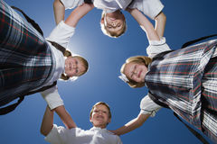 Friends Forming Huddle Stock Images