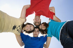 Friends Forming A Huddle Against Sky Royalty Free Stock Image