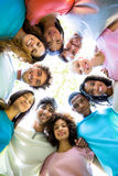 Friends forming huddle Stock Image