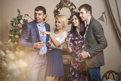 Friends of four men and women with bacale celebrate with champag Stock Photography