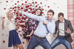 Friends of four men and women are dancing and laughing having fu Royalty Free Stock Images
