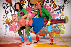 Friends fun graffiti wall Royalty Free Stock Photo