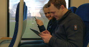 Friends with Gadgets on Train stock video footage