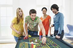 Friends Gambling At Roulette Table Royalty Free Stock Photo