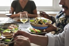 Friends gather having Italian food together royalty free stock photography
