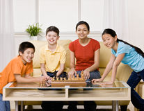 Friends gathering to play chess Stock Photo