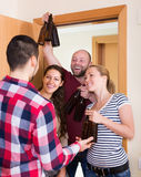 Friends gathering together at party Royalty Free Stock Image