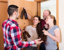 Friends gathering together at party Stock Images