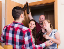 Friends gathering together at party Royalty Free Stock Photography