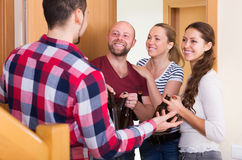 Friends gathering together at party Stock Image