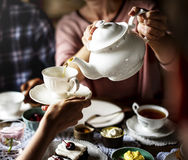 Friends Gathering Together on Tea Party Eating Cakes Enjoyment h Stock Photography