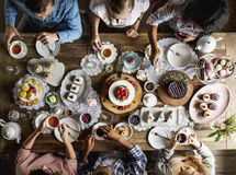 Friends Gathering Together on Tea Party Eating Cakes Enjoyment h Stock Image