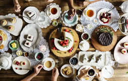 Friends Gathering Together on Tea Party Eating Cakes Enjoyment h Stock Photos