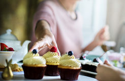 Friends Gathering Together on Tea Party Eating Cakes Enjoyment h Royalty Free Stock Images