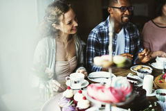 Friends Gathering Together on Tea Party Eating Cakes Enjoyment h Royalty Free Stock Image