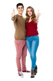 Friends gesturing thumbs up sign. Young couple showing double thumbs up Royalty Free Stock Photo