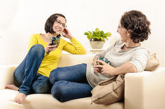 Friends girls coffee home chat happy faces laughing Royalty Free Stock Photography