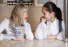 Friends Girls Fun On Kitchen With An Alcohol Glass Stock Photos