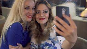 Friends girls taking selfie with a smart phone and making faces and fun. Friends taking selfie with smart phone and making faces and fun stock video