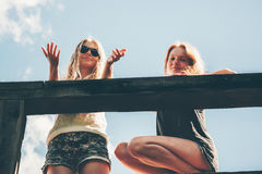 Friends girls walking together happy smiling talking Stock Photos