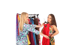 Friends give pieces of advice to each other concerning the clothes. Studio Royalty Free Stock Image