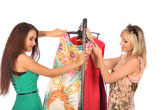 Friends give pieces of advice to each other concerning the clothes. Studio Royalty Free Stock Photography