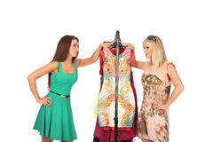 Friends give pieces of advice to each other concerning the clothes. Studio Stock Image