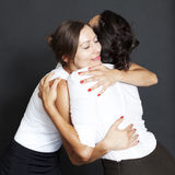 Friends giving a hug. Two female friends giving each other a hug Stock Photos