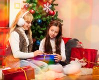 Friends giving presents each other Stock Photography