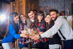 Friends with glasses at the celebration in restaurant have fun a Stock Photo