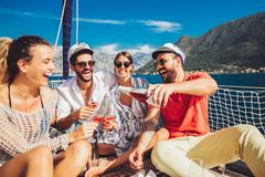 Friends with glasses of champagne on yacht. Vacation, travel, sea, friendship and people concept stock photos