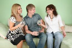 Friends with glasses on sofa Stock Photography