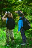 Friends go hiking. Two boys friends go hiking with backpacks. Summer holidays. Outdoor activities stock photos
