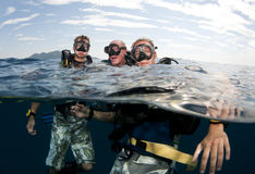Friends  go scuba diving Stock Images