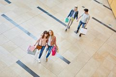 Friends go for a shopping spree. In the shopping mall royalty free stock photos