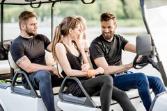 Friends in the golf cart Stock Image