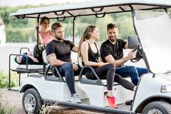 Friends in the golf cart Royalty Free Stock Photo